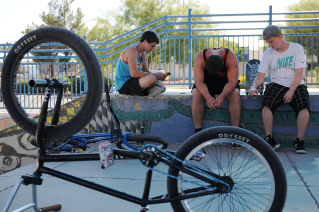 Nick Fraser, 14, from left, Dakota Waddell, 20, and Ronnie Selby, 19, cool down after riding their bikes and skateboards at the Winchester Skate Park in Las Vegas Monday, June 30, 2014. An excessi ...