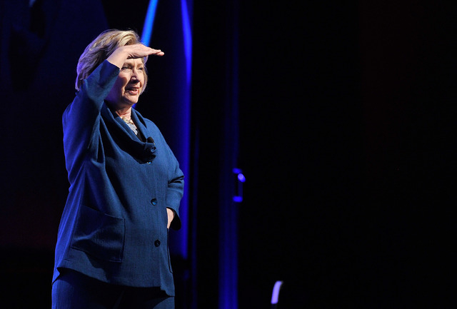 Former Secretary of State Hillary Clinton looks into the crowd after a person threw an object at her while speaking during The Institute of Scrap Recycling Industries' annual conference at the Man ...