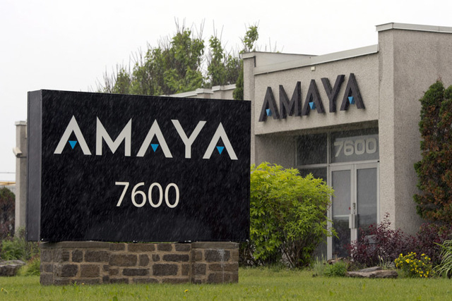 The Amaya Gaming Group headquarters are shown in Montreal. Amaya has begun submitting documents required for a determination on whether PokerStars can be licensed in New Jersey. (AP Photo/The Cana ...