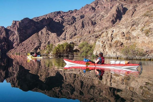 Boaters paddle on the Colorado River downstream from Hoover Dam on a 30-mile stretch just named as a National Water Trail. (Courtesy, Izzy Collett, Desert Adventures)