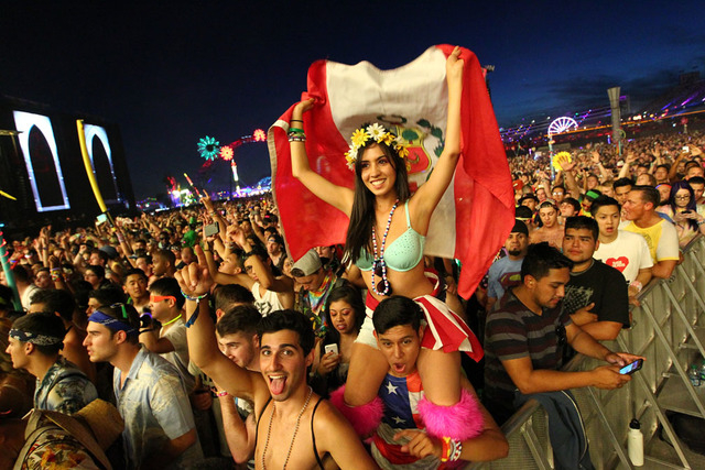 Fans watch as The Glitch Mob performs at the Kinetic Field stage at the Electric Daisy Carnival at the Las Vegas Motor Speedway in Las Vegas on Friday, June 20, 2014. (Chase Stevens/Las Vegas Revi ...
