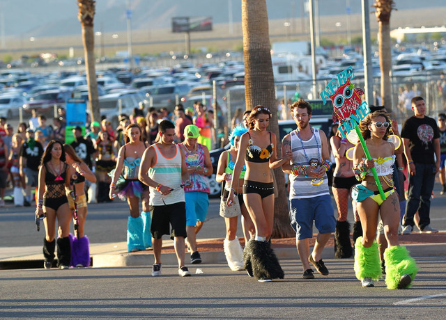 Fans walk towards the entrance to the Electric Daisy Carnival at the Las Vegas Motor Speedway in Las Vegas on Friday, June 20, 2014. (Chase Stevens/Las Vegas Review-Journal)