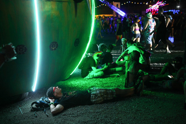 An attendee takes a break by an art installation at the Electric Daisy Carnival at the Las Vegas Motor Speedway in Las Vegas on Friday, June 20, 2014. (Chase Stevens/Las Vegas Review-Journal)