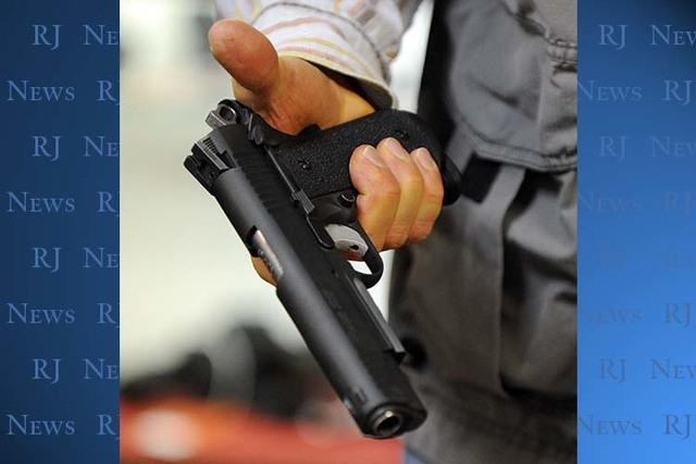 A customer handles a Sig Sauer hand gun at Discount Firearms and Ammo on Saturday, Oct. 26, 2013. (David Becker/Las Vegas Review-Journal)