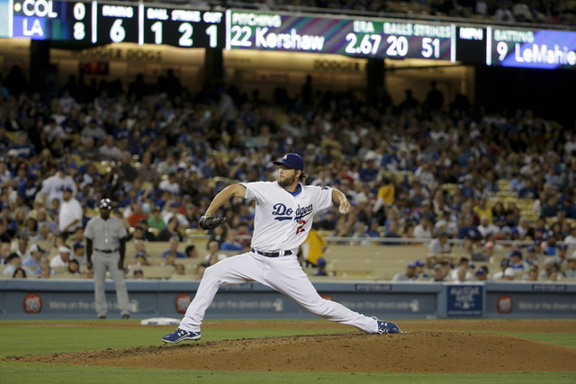 Los Angeles Dodgers starting pitcher Clayton Kershaw throws against the Colorado Rockies during sixth inning of a baseball game in Los Angeles, Wednesday, June 18, 2014. (AP Photo/Chris Carlson)