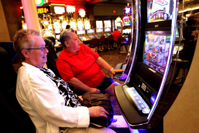Carol Hartman, left, and Jeanette Gonsalves (cq), both of Modesto, Calif., play the new NASCAR slots at Main Street Station in Las Vegas Tuesday, June 25, 2013. The new slots were first launched i ...