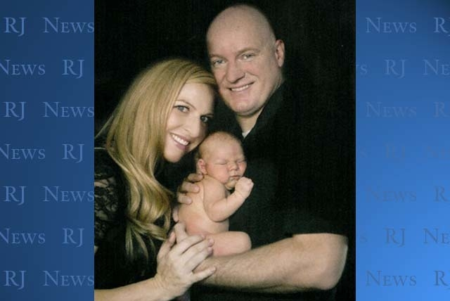 Andrea and Igor Soldo pose with their infant son. (Courtesy/Lincoln Journal Star).