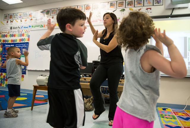 Amanda Sizemore of The Beat Dance Academy teaches 3-year-olds how to dance at Shenker Academy's summer camp (Samantha Clemens-Kerbs/Las Vegas Review-Journal)