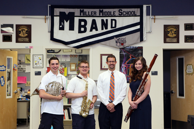 Band Director Jeff Williams, third from left, stands with his former students Ryan Everson, 17, from left, Connor O'Toole, 17, and Kelly Haines, 16, at Miller Middle School Thursday, June 5, 2014, ...