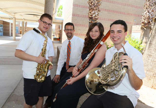 Band Director Jeff Williams, second from left, stands with his former students Connor O'Toole, 17, from left, Kelly Haines, 16, and Ryan Everson, 17, at Miller Middle School Thursday, June 5, 2014 ...