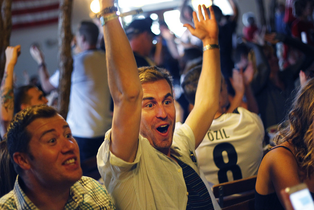 Jordan Kelley, middle, reacts after Germany scored a goal against Ghana during the World Cup soccer game at the Hofbrauhaus in Las Vegas on June 21, 2014. (Jason Bean/Las Vegas Review-Journal)