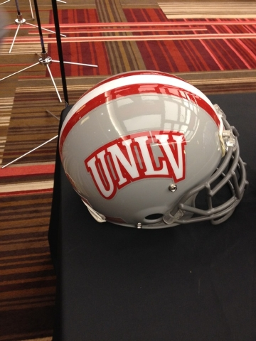 A UNLV football helmet is displayed at Mountain West media day at the Cosmopolitan on Wednesday.  (Lori Cox/Las Vegas Review-Journal)