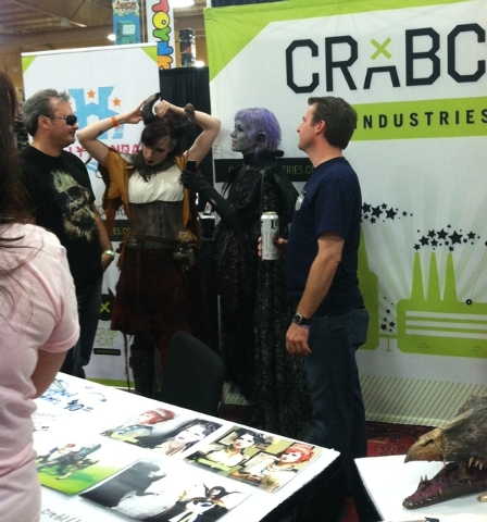 Jessica Merizan, left, and Holly Conrad of Crabcat Industries stop to speak with Amazing Las Vegas Comic Con-goers. (ASHLEY CASPER, LAS VEGAS REVIEW-JOURNAL)