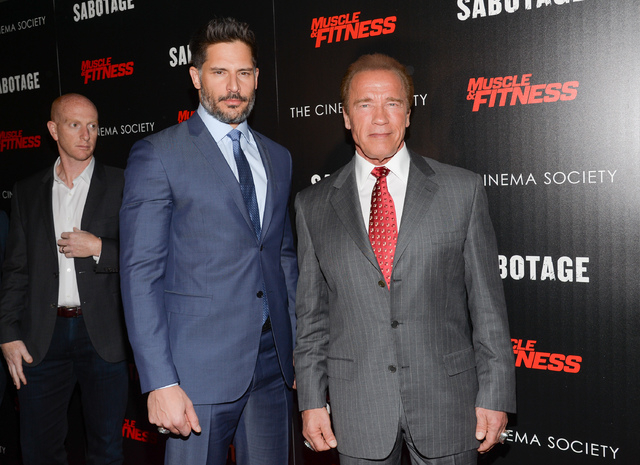 "In this Tuesday, March 25, 2014 file photo, actors Joe Manganiello, left, and Arnold Schwarzenegger attend a special screening of Open Road Films' ""Sabotage,"" hosted by The Cinema Societ ..."