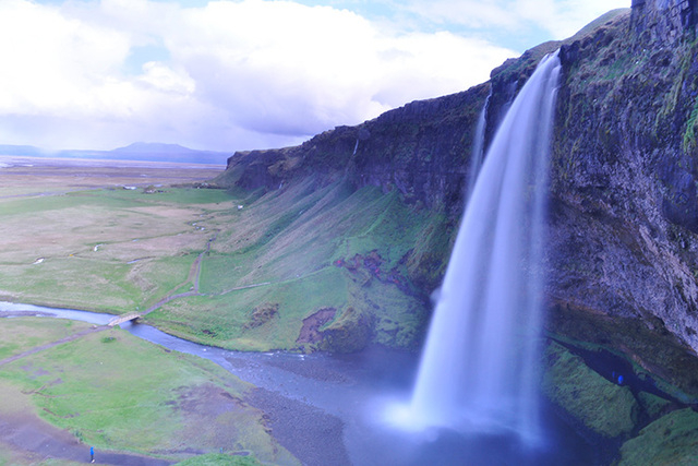 This 2011 photo provided by Vanessa Giacoppo shows a waterfall in Iceland. Giacoppo took the photograph on a private tour of Iceland with a guide, Tony Prower, who takes visitors to waterfalls and ...