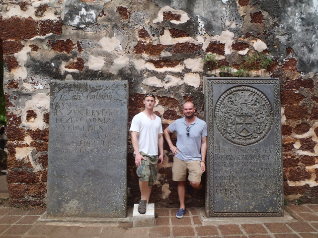 This 2012 photo provided by Jeremy Hanson shows Hanson, left, and a friend, Stephen Conroy, in Malacca, Malaysia, where they hired a private tour guide to take them around. Hanson often hires loca ...
