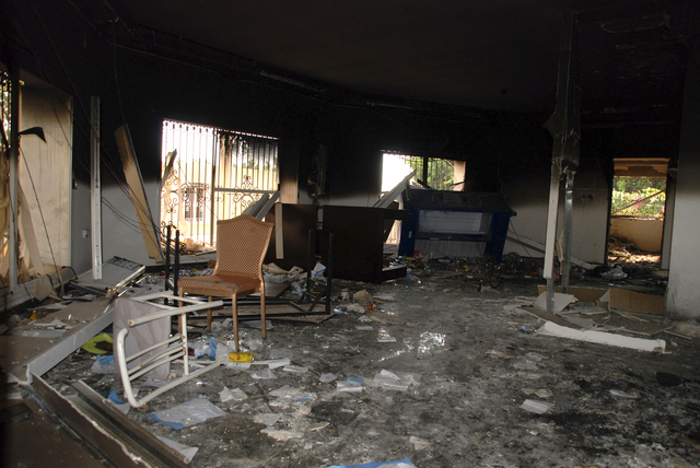 This Sept. 12, 2012 file photo shows glass, debris and overturned furniture are strewn inside a room in the gutted U.S. consulate in Benghazi, Libya, after an attack that killed four Americans, in ...