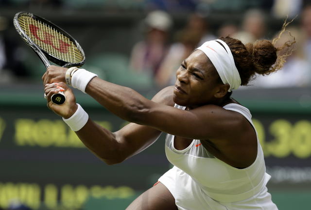 Serena Williams returns to Sabine Lisicki, of Germany, during a women's singles match at Wimbledon in London on July 1, 2013. (AP Photo/Alastair Grant, File)