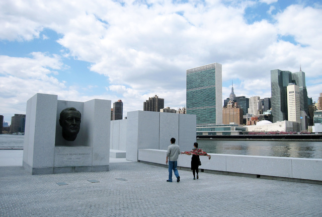 This May 1, 2014 photo shows visitors taking pictures in front of a bust of President Franklin D. Roosevelt at Franklin D. Roosevelt Four Freedoms Park, located on Roosevelt Island in New York Cit ...