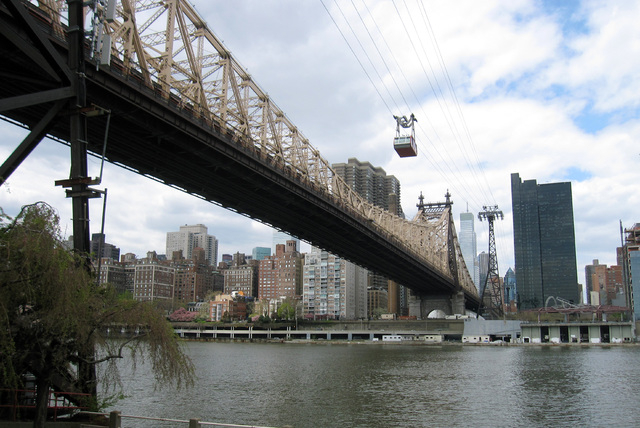 This May 1, 2014 photo shows the Roosevelt Island Tram above the Ed Koch Queensborough Bridge, crossing the East River to Roosevelt Island in New York City. The island is home to the Franklin D. R ...