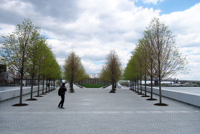 This May 1, 2014 photo shows a visitor taking pictures at Franklin D. Roosevelt Four Freedoms Park, located on Roosevelt Island in New York City, with the Ed Koch Queensborough Bridge in the dista ...