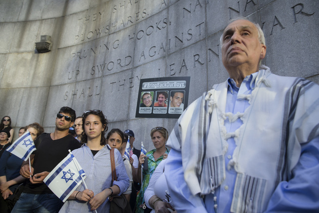 Rabbi Avi Weiss, right, stands with demonstrators during a memorial service outside the United Nations headquarters for the three missing Israeli teenagers whose bodies were found by the Israeli m ...
