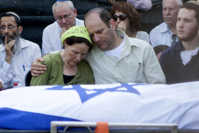 Avi and Rachel Fraenkel embrace during the funeral of their son, Naftali, a 16-year-old with dual Israeli-American citizenship, in the West Bank Jewish settlement of Nof Ayalon, Tuesday, July 1, 2 ...