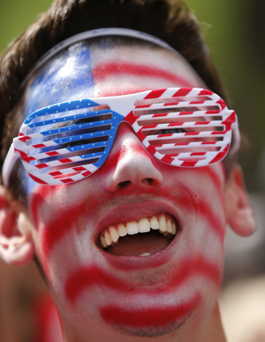 United States fan Joe Trombley, of Farmington, Mich., reacts while watching the 2014 World Cup soccer match between the United States and Belgium at a public viewing party, in Detroit, Tuesday, Ju ...