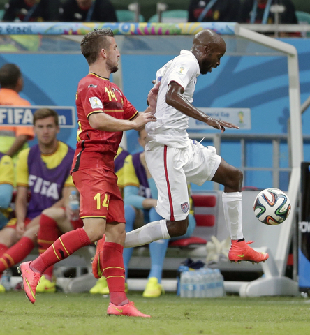Belgium's Dries Mertens, left, pushes United States' DaMarcus Beasley to get him out of bounds during the World Cup round of 16 soccer match between Belgium and the USA at the Arena Fonte Nova in  ...
