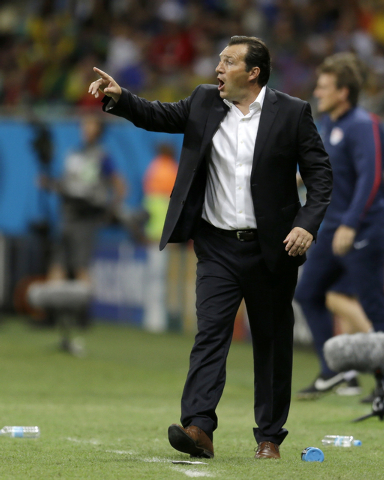 Belgium's head coach Marc Wilmots yells out to his players during the World Cup round of 16 soccer match between Belgium and the USA at the Arena Fonte Nova in Salvador, Brazil, Tuesday, July 1, 2 ...