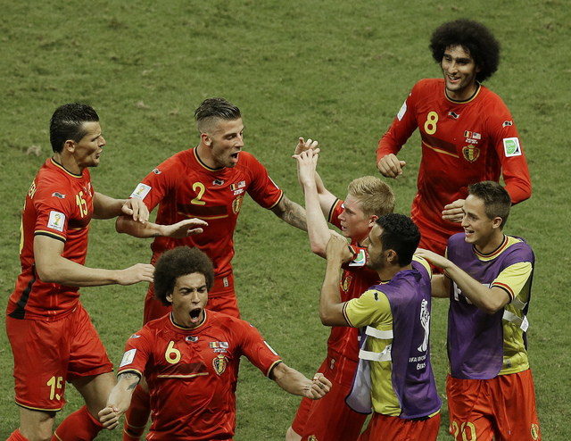 Belgium's Kevin De Bruyne, center right, celebrates scoring the opening goal during the World Cup round of 16 soccer match between Belgium and the USA at the Arena Fonte Nova in Salvador, Brazil,  ...