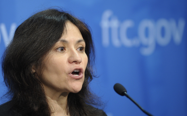 Federal Trade Commission Chair Edith Ramirez speaks at the FTC in Washington in this Jan. 15, 2014, file photo. T-Mobile USA knowingly made hundreds of millions off its customers in bogus charges, ...