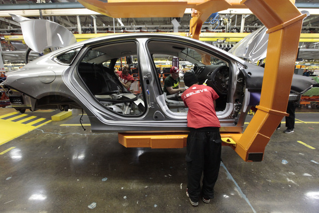 In this Friday, March 14, 2014 photo, assembly line workers build a 2015 Chrysler 200 automobile at the Sterling Heights Assembly Plant in Sterling Heights, Mich. Chrysler's U.S. auto sales jumped ...