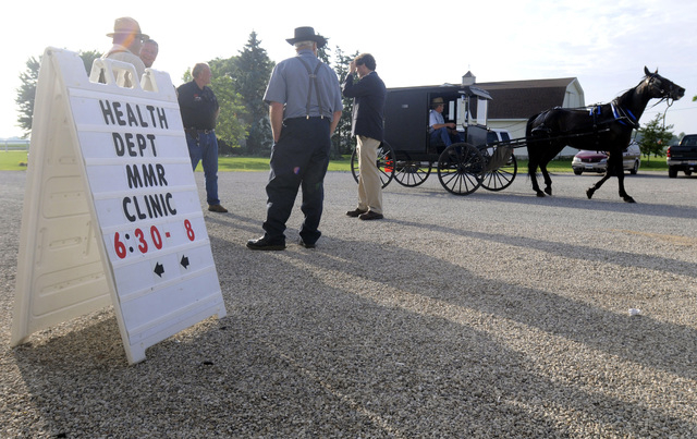 A horse and buggy arrive at the Health and Safety clinic that included measles, mumps and rubella vaccinations for the Mennonite community of Richland County in Shiloh, Ohio, on June 25, 2014. Hea ...