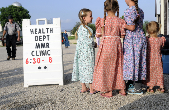 Young Mennonite girls gather at the health and safety clinic, which included a measles, mumps and rubella vaccinations in Shiloh, Ohio, on June 25, 2014. Health officials said Ohio's current outbr ...