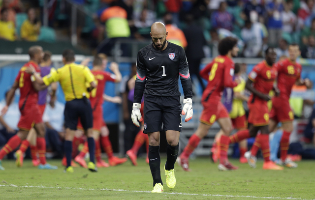 United States' goalkeeper Tim Howard reacts after Belgium's Kevin De Bruyne scored the opening goal during the World Cup round of 16 soccer match between Belgium and the USA at the Arena Fonte Nov ...