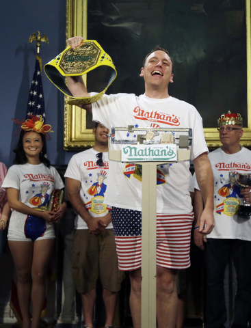 Seven-time hot dog eating champion, Joey Chestnut, poses while weighing in during a news conference to promote Friday's Nathan's Famous Fourth of July International Hot-Dog Eating Contest, Thursda ...