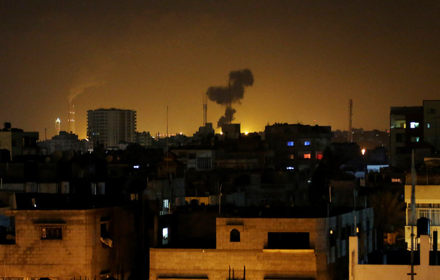 Smoke rises after an Israeli missile strike in Beit Lahia, northern Gaza Strip, early Monday, July 7, 2014.  The Islamic militant group Hamas that rules Gaza vowed revenge on Israel for the death  ...