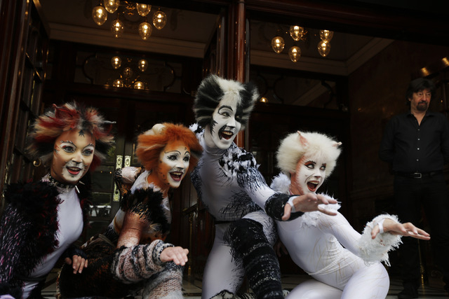 Performers in Cats costumes pose for the photographers during a photo-op to promote the return of British composer Andrew Lloyd Webber's Cats the musical return to London, Monday, July 7, 2014. Br ...