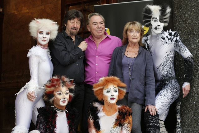 British composer Andrew Lloyd Webber, centre, director Trevor Nunn, left, and choreographer Gillian Lynne, centre right, pose for the photographers with performers in cat costumes, during a photo- ...