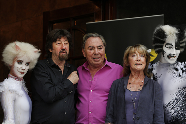 British composer Andrew Lloyd Webber, centre, director Trevor Nunn, centre left, and choreographer Gillian Lynne, centre right, pose for the photographers with performers in cat costumes, during a ...