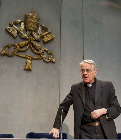 Vatican spokesman the Rev. Federico Lombardi arrives for a press conference at the Vatican, Monday, July 7, 2014. Pope Francis has held his first meeting with a group of Catholics who were sexuall ...