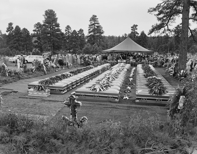 Nearly 400 relatives and friends of the 70 people who died in the crash of a TWA Super-Constellation over the Grand Canyon on June 30, 1956, attend a mass funeral service in Flagstaff, Ariz., on J ...