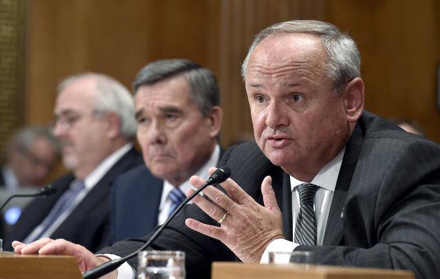 U.S. Immigration and Customs Enforcement Principal Deputy Assistant Secretary Thomas Winkowski, right, seated next to as Federal Emergency Management Agency administrator Craig Fugate, left, and U ...
