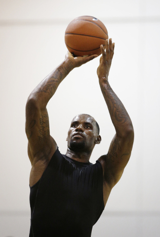 Lebron James shoots a free throw while playing with high school students during the Lebron James Skills Academy Wednesday, July 9, 2014, in Las Vegas. (AP Photo/John Locher)