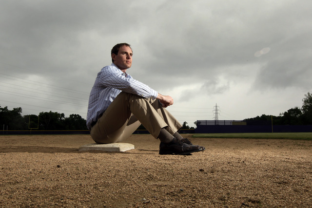 In this May 23, 2013, file photo, Garrett Broshuis poses for a photo at a baseball field in St. Louis. Broshuis is the driving force of a lawsuit against Major League Baseball, alleging violations ...