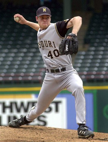In this May 26, 2004 file photo, Missouri pitcher Garrett Broshuis (40) throws in the first inning against Oklahoma during the Big 12 Conference championship tournament in Arlington, Texas. Broshu ...