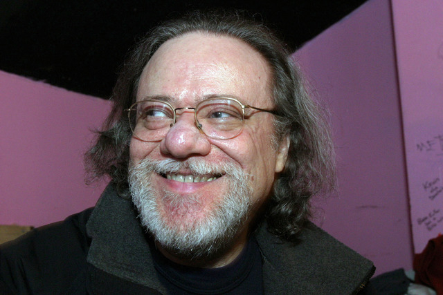 In this Jan. 8, 2005, file photo, Tommy Ramone, ex-drummer and manager of The Ramones, smiles as he is interviewed backstage at the Knitting Factory in New York. A business associate says Ramone,  ...