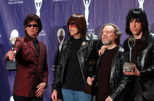 In this March 18, 2002, file photo, members of the Ramones, from left to right, Dee Dee, Johnny, Tommy and Marky Ramone hold their awards after being inducted at the Rock and Roll Hall of Fame ind ...