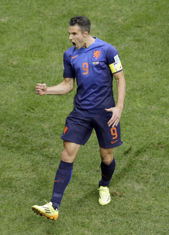 Netherlands' Robin van Persie celebrates after scoring a penalty during the World Cup third-place soccer match between Brazil and the Netherlands at the Estadio Nacional in Brasilia, Brazil, Satur ...
